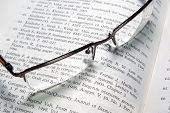 Glasses Laying On Book.