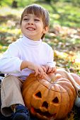 Happy Little Boy With Halloween Pumpkin