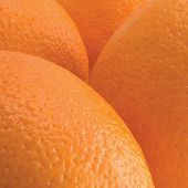 Oranges, orange fruits peel texture macro closeup, detailed studio shot textured pattern background