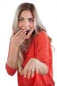 Astonished woman with engagement ring on a white background