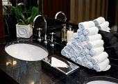 Restroom in hotel or restaurant, focus on towels