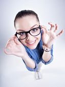 stock photo of dork  - pretty girl with perfect teeth wearing geek glasses smiling - JPG