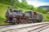 MOKRA GORA, SERBIA-JULY 14: The locomotive of  Shargan Eight railway on July 14,2013. It is a narrow