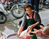 TAIPEI, TAIWAN - JANUARY 18: A local prepares ducks on a sidewalk January 28, 2013 in Taipei, TW. Street food and night markets are an important part of the culinary culture of Taipei.