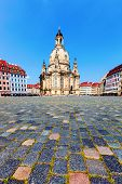 DRESDEN GERMANY JUNE 20: Tourist in front the Dresden Frauenkirche on June 20 2013 Dresden Germany. Built in the 18th