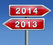 stock photo of crossroads  - new year 2014 next and previous years the future starting from the end of 2013 road sign arrow - JPG