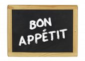 Bon appetit (enjoy your meal) on a blackboard on a white background