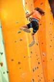 Child Sliding Down The  Climbing Wall