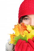 Autumn woman happy with colorful fall leaves isolated on white background in studio. Cheerful girl h
