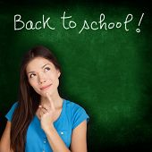 Back to school blackboard - woman student thinking. Female college university student girl thinking