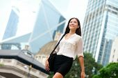 Asian Business woman walking outside in Hong Kong. Asian businesswoman office worker in downtown bus