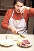 Woman cuts onions