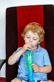 Little Boy Drinking Colorful Frozen Slush Ice