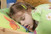 Four-year-old girl sleeping in the crib