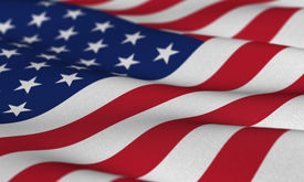 stock photo of waving american flag  - Flag of the USA waving in the wind with very shallow depth of field - JPG
