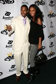 Nick Cannon and Joy Bryant at the birthday party for Nick Cannon and the opening of his flagship sto