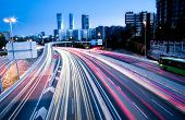 stock photo of commutator  - Blurred Tail Lights And Traffic Lights On Motorway