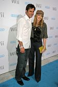 Jonathan Silverman and Jennifer Finnigan at the party celebrating the launch of Nintendo's Game Console Wii. Boulevard 3, Los Angeles, California. November 16, 2006.