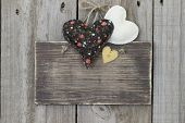 Rustic brown sign with country hearts