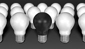 One Black Light Bulb Among Many White Ones On Grey Textured Background poster