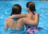 Two Girls Standing In Pool