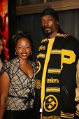 Snoop Dogg with guest at the premiere of