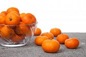 Fresh Clementines fruit with glass bowl