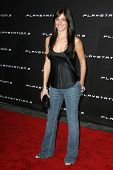 LOS ANGELES - OCTOBER 08: Minka Kelly at the Playstation 3 Launch Party October 08, 2006 in 9900 Wilshire Blvd, Beverly Hills, CA.