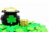stock photo of pot  - St Patricks Day Pot of Gold and shamrocks over white - JPG
