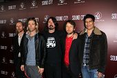 Nate Mendel, Taylor Hawkins, Dave Grohl, Chris Shiflett, Pat Smear at the
