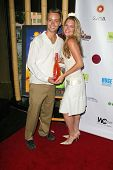 SANTA MONICA - JULY 23: Katie Whicker and Sean Davis at the Sexy Summer Soire Party hosted by H.U.G.