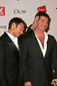 HOLLYWOOD - AUGUST 27: Ryan Seacrest and Simon Cowell at the TV Guide Emmy After Party August 27, 2006 in Social, Hollywood, CA.