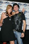 WEST HOLLYWOOD - JULY 13: Storm Large and Josh Logan at the party for the new season of