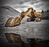 stock photo of earth-mover  - Earth Mover near water pond color photo