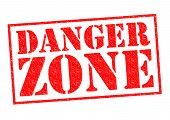 stock photo of dangerous situation  - DANGER ZONE red Rubber Stamp over a white background - JPG