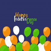 Happy Independence Day celebrations concept with balloons in national flag colors on blue background