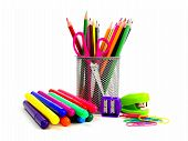 Group of school supplies on white