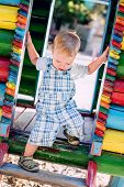 stock photo of descending  - descends toddler boy at the playground in summer - JPG