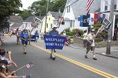 The Wellfleet Democrats walking in the Wellfleet 4th of July Parade in Wellfleet, Massachusetts