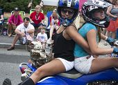 Wellfleet, Massachusetts, USA-July 4, 2014: Two young women riding on a motorcycle in the Wellfleet