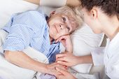 pic of nursing  - Elderly woman in bed and her nurse - JPG