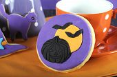 Happy Halloween Party Trick Or Treat Purple And Orange Cookie Close Up With Pumpkin And Flying Bats