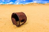 old broken rusty can in sand desert