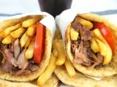 stock photo of souvlaki  - Greek Gyros or kebab with potatoes and pita - JPG