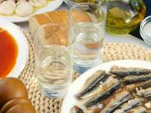 stock photo of ouzo  - Greek ouzo or tsipouro with misc seafood - JPG