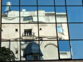Old church mirrored in new office building, Bucharest