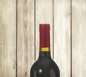 Red Wine bottle and glass on wood background