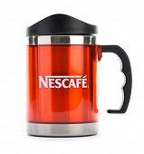 Ankara, Turkey - April 12, 2013: Promotional Nescafe red mug isolated on white background.