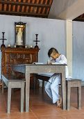 Young Boy Monk Studying In Classroom At Royal Buddhist Thien Mu Pagoda.