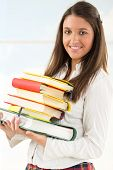 Happy Female Student With Books